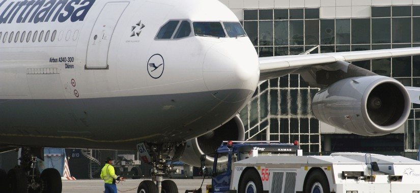 A Fraport tractor pulls a Lufthansa A340-300 on the runway