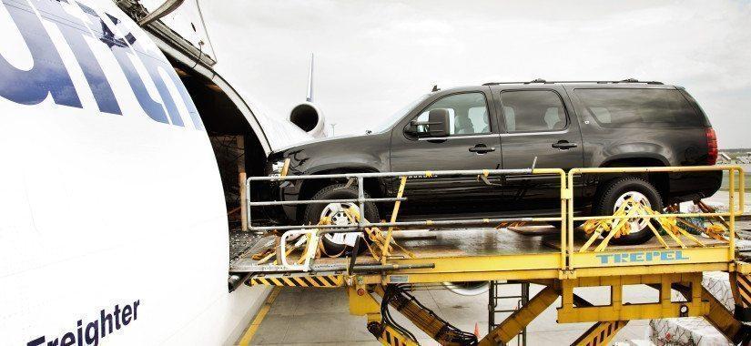 A car being loaded onto a Lufthansa Cargo MD-11F