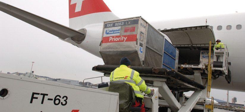 A Swissport aircraft unloading